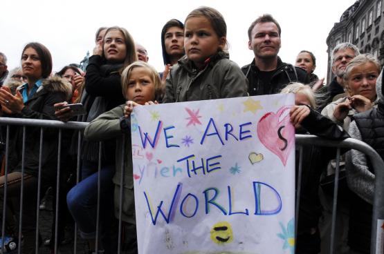 De regeringspolitiek valt niet bij iedereen in de smaak. Dat bleek uit een getuigenis op deze betoging in Kopenhagen, die pleitte voor een opvangbeleid dat de rechten van de mens respecteert. (Foto Flickr, Klaus Berdiin Jensen)